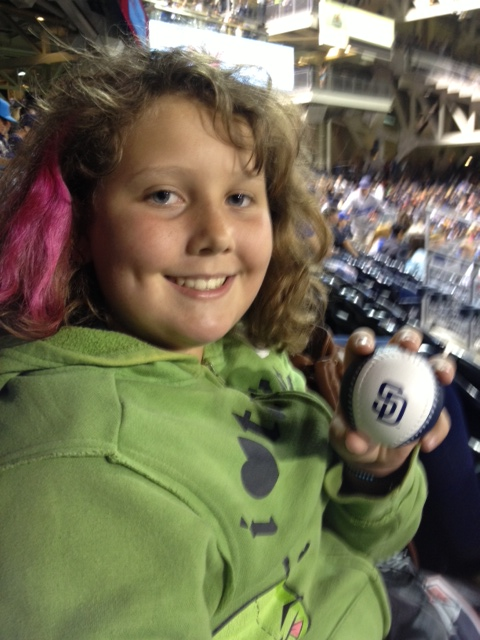Aurora with her souvenir baseball from the Padres v. Dodgers game!