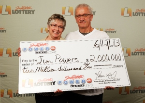 Jim and Barb Powers of Rapid City, SD with their 2 million dollar win from the June 5th Powerball Drawing! (Photo from Black Hills Fox News)