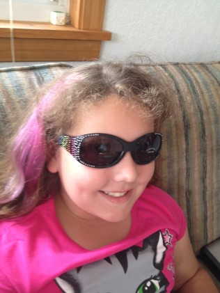 "Aurora's new ""bling"" sunglasses! Only $6.00 at Untamed Accessories and Clothing, downtown Rapid City!"