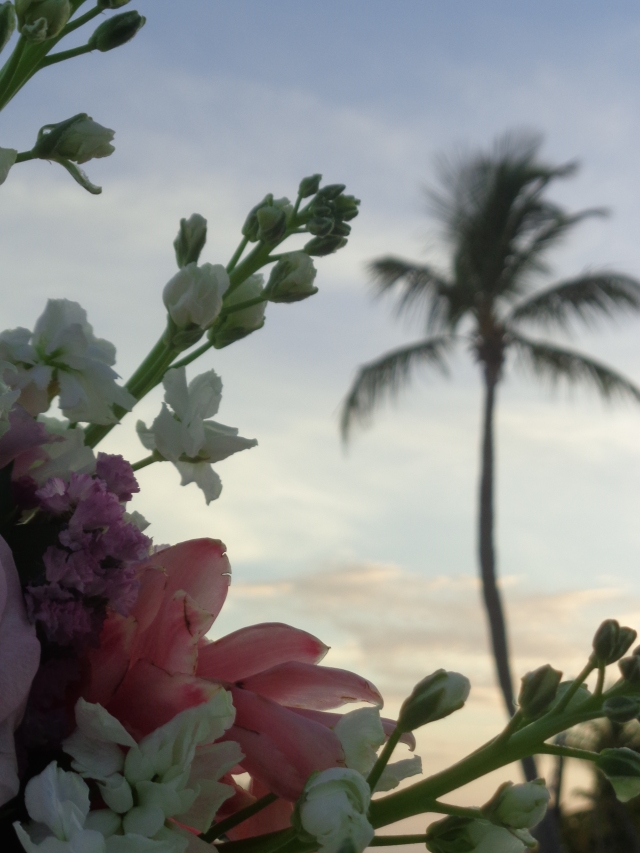 A photo of my Wedding Bouquet with a palm tree silhouetted in the background taken on my Wedding Day, July 3, 2014!   Smathers Beach, Key West, FL