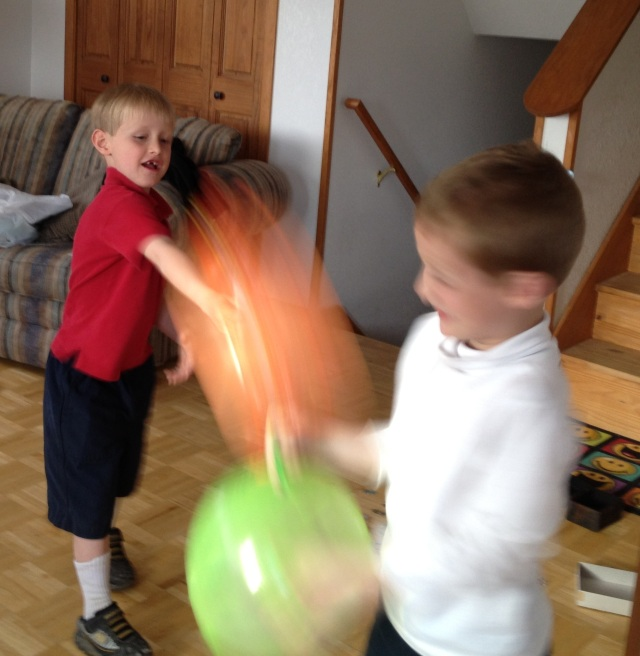 Seth and Noah battle with punching balls