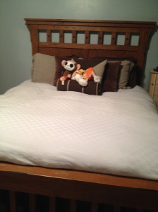 Oh my gosh, I DID it!  There really WAS a bed underneath all of that!